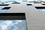 Edificio 24 viviendas, locales y aparcamiento entre medianeras